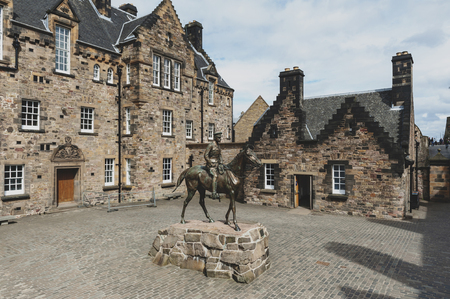 Edinburgh, Scotland - April 2018: The imposing equestrian statue of Field Marshal Earl Haig situated outside the National War Museum at Hospital Square in Edinburgh Castle, Scotland Editorial