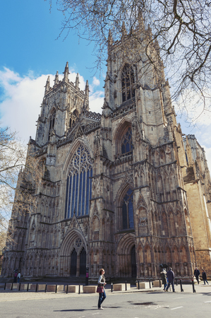 York, England - April 2018: York Minster, the historic cathedral built in English gothic architectural style and major tourist landmark of the City of York in England, UK