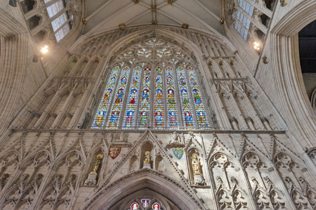 York, England - April 2018: Gothic tracery on The Great West Window called Heart of Yorkshire, installed at the nave inside York Minster depicting the Joys of the Virgin Mary above figures of the Apostles and the medieval Bishops and Archbishops of York Editorial