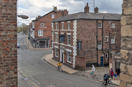 York, England - April 2018: Old brick buildings at street corner on Monkgate and St Maurice Road in historic district of City of York, England, UK 에디토리얼