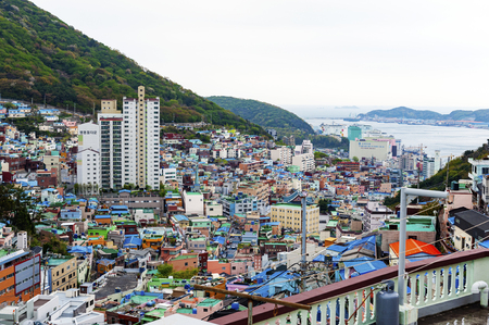 Scenic landscape of Gamcheon Culture Village, colorful and artistic tourist attraction with brightly painted houses on hillside of coastal mountain in Saha District, Busan, South Korea Stok Fotoğraf