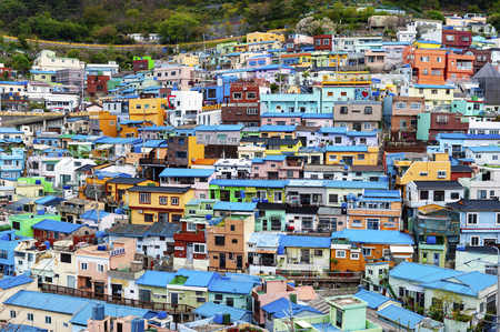Scenic landscape of Gamcheon Culture Village, colorful and artistic tourist attraction with brightly painted houses on hillside of coastal mountain in Saha District, Busan, South Korea Stockfoto
