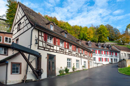 Schaffhausen, Switzerland - October 2019: Old buildings located along the narrow street from Neuhausen Rheinfall station to the Rhine Falls, famous and biggest waterfall in Europe on the Rhine River in Switzerland