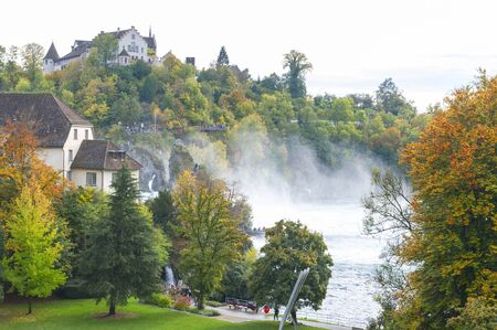 Mighty white rapids of the Rhine River at the Rhine Falls, the famous and biggest waterfall in Europe located in Schaffhausen, Switzerland