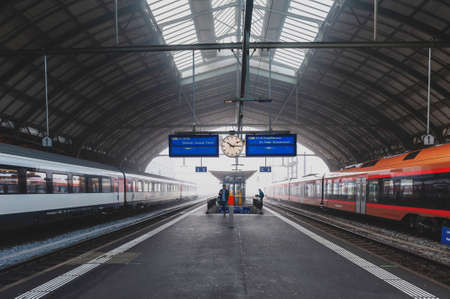 St. Gallen, Switzerland - October 2019: St Gallen railway station, the central station of the St. Gallen S-Bahn and the Appenzell Railways (AB), owned and operated by Swiss Federal Railways (SBB CFF FFS) in Switzerland Sajtókép