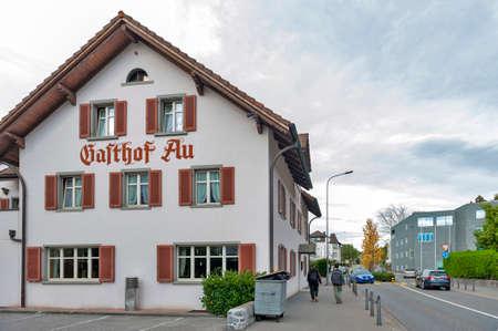 Vaduz, Liechtenstein - October 2019: Building exterior of Gasthof Au, one of the oldest restaurants and taverns situated on Austrasse Road in Vaduz, capital city of Liechtenstein