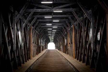 Vaduz, Liechtenstein - October 2019: Interior of the Alte Rheinbrücke, an old wooden roofed bridge over the river Rhine on border between municipalities of Vaduz in Liechtenstein and Sevelen in Switzerland