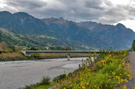 The river Rhine, a natural country border between municipalities of Vaduz in Liechtenstein and Sevelen in Switzerland
