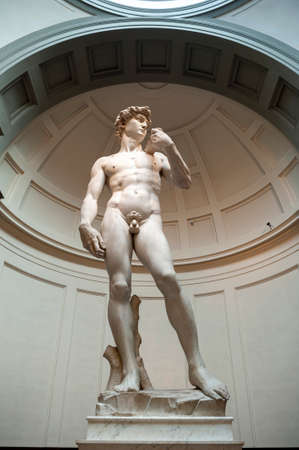 Florence, Italy - October 2019: The famous anatomical statue of David by Michelangelo exhibited at the Galleria dell'Accademia di Firenze (Gallery of the Academy of Florence) in Florence, Italy Editorial