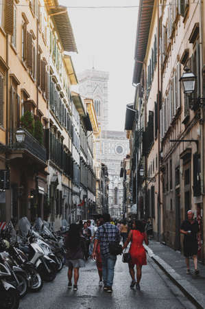 Florence, Italy - October 2019: Street in historic center of Florence, capital city of the Tuscany region of Italy, leading to Florence Cathedral of Saint Mary of the Flower (Santa Maria del Fiore) Редакционное