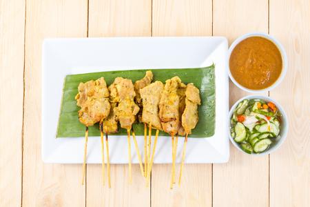 thailand food: Grilled pork set on wood table , thai food style