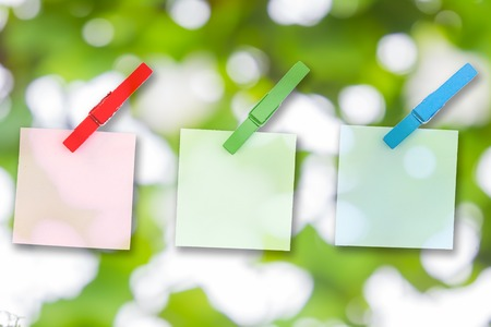 memorize: Paper color and wood clip note on Green bokeh