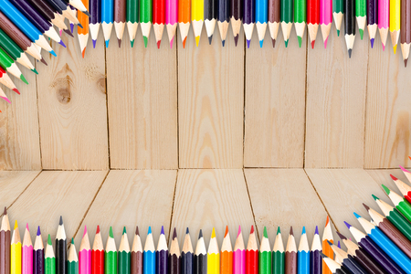 wood backgrounds: Frame of Colour pencils on wood texture background