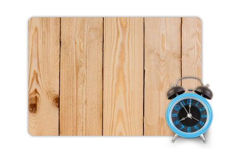 reloj: Alarm clock on wood texture for background.
