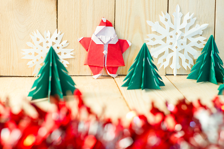 klaus: Christmas concept paper craft on wooden floor, Selective focus, shallow depth of field, abstract background for happy new year. Stock Photo