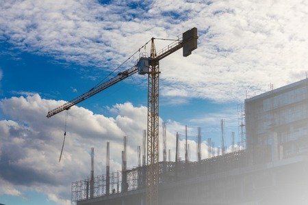Crane working in construction site on blue sky and cloud. Stock Photo