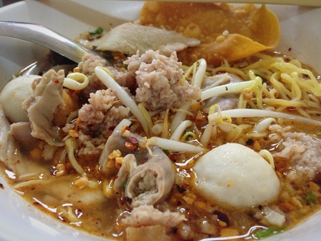 closeup: Spicy thai egg noodle with pork and fishball