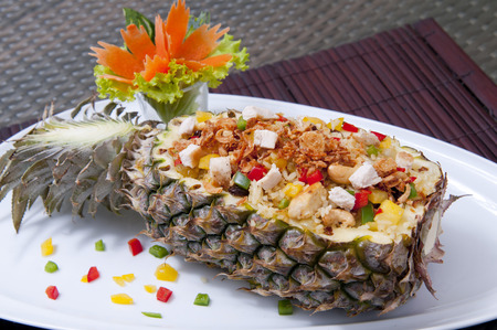 Fried rice with seafood served in a pineapple