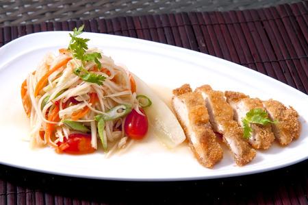 Food and cuisine. Thai food. papaya salad with grilled chicken. Green papaya salad or Som Tum Stock Photo