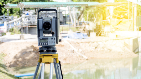 Surveyor equipment tacheometer or theodolite outdoors at construction site for civil engineer checking the construction area