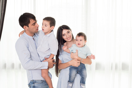 cute guy: Mother and father holds on a hands their little children Stock Photo