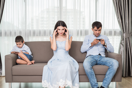 cute guy: Family members distracted by technology phone and lifestyle concept