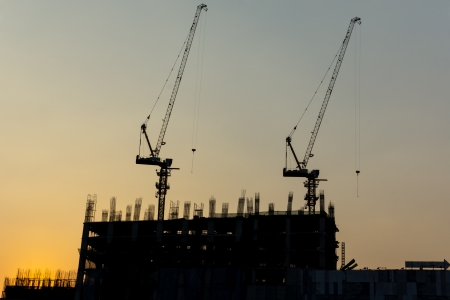 Crane are working built construction concrete and steel Stock Photo