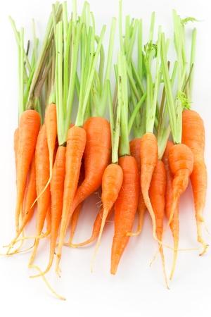 Fresh orange small carrots isolated background white Stock Photo