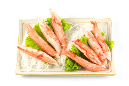 Imitation crab placed on the plate and vegetables