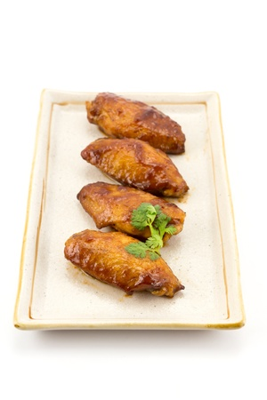 Chicken wings and red sauce with coriander Stock Photo