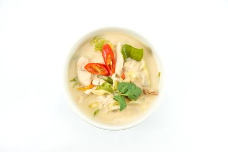 Thai food Tom-kha-gai Intense soup decorate with coriander and capsicum
