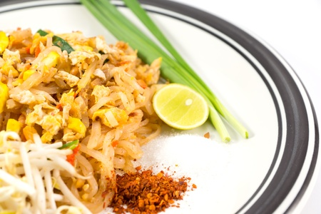 thinness: Pad-thai on plate and side dishes on white background