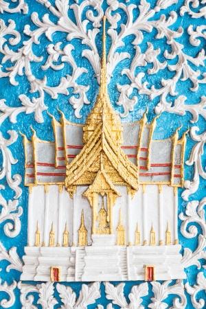 Thai sculpture on the blue door