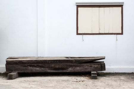 Old bench and white wall with window Stock Photo