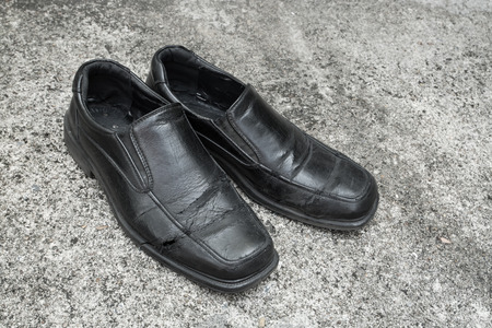 wornout: Black old shoes it dirty and worn-out
