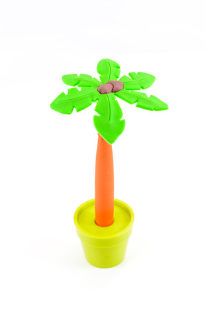Coconut tree plastic model on white background isolated