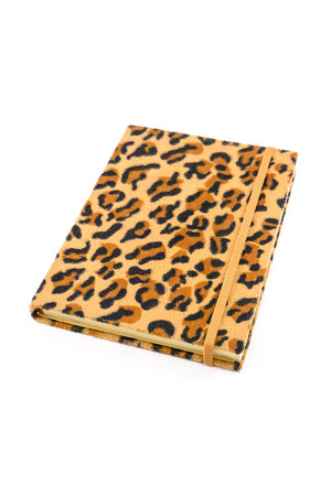 Notebook leopard cover on isolated white background