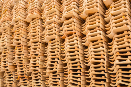 Clay roof tiles orange placed in a row