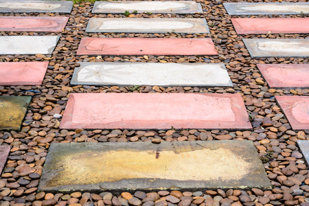 a rectangular brick walkway and pebble Stock Photo