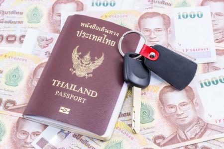 Thai Money 1000 Bath with passport and a car key Stock Photo
