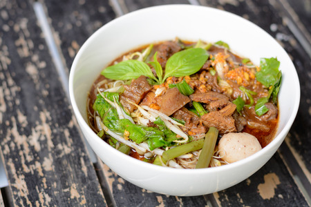 intense: Noodle soup with intense flavor and beef, Thai local food. Stock Photo