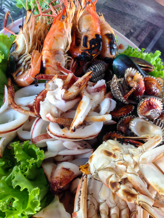 grilled mixed seafood on a plate Thai local food