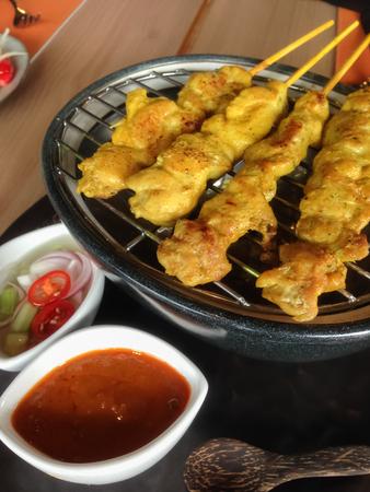 grilled pork satay with peanut sauce and toast thai local food