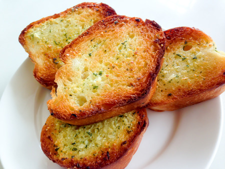 nutriments: garlic bread on white dish Stock Photo