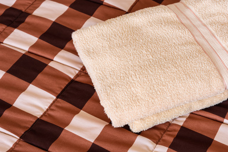 laundered: Freshly fluffy towels cream colour in bedroom