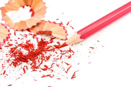 sharpening: Colour pencill with sharpening shavings on white background Stock Photo