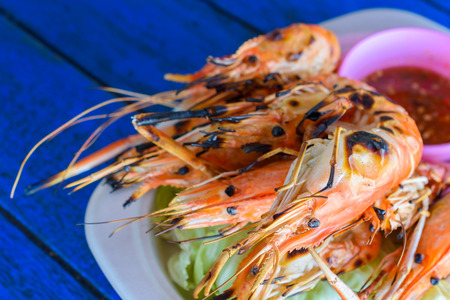parch: grilled shrimp with seafood sauce on a plate, Thai local food.