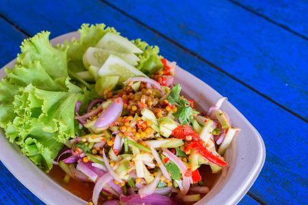 horseshoe crab egg salad on a plate Thai local food