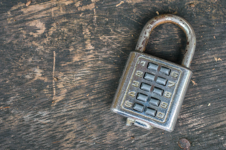 combination: combination lock on old wooden table