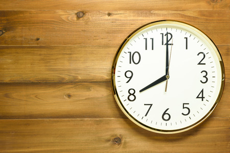 wall clock on the wooden wall at time 8am or 8pm